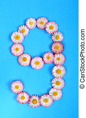 The number 9 is written in white pink flowers on a blue background.