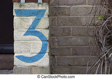 The Number Three Painted on a Brick Wall