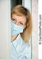 The nurse behind a door