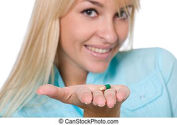 The nurse with a capsule on a palm