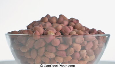 The nut peanut rotates on the turntable. - Nuts peanut turn...