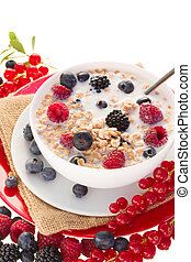 The oat flakes with berries on white
