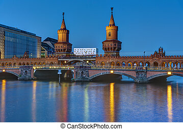The Oberbaumbridge and the river Spree in Berlin at night