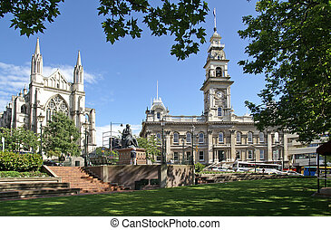 The Octagon, center of Dunedin, New Zealand, with St. Paul Cathedral to the left and Municipal Chambers to the right