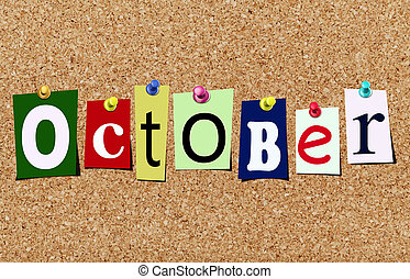 The october magazine cutout letters pinned to cork noticeboard