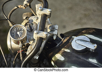 The odometer of a vintage motorcycle