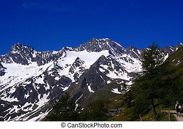 deep blue sky and snow-capped mountains of the Oetztal Alps in South Tyrol