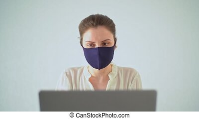 The office worker complies with prevention measures against viruses. Office quarantine, caution and security 4k