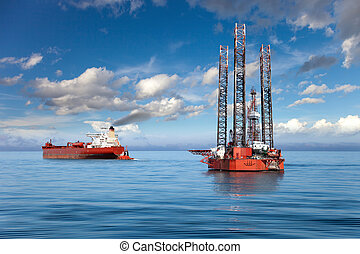 The offshore drilling oil rig. - Oil rig and tanker ship on...