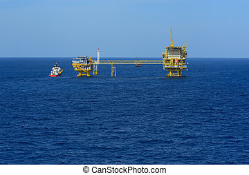 The offshore oil rig and supply boat