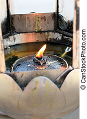 The oil lamps in the temple.