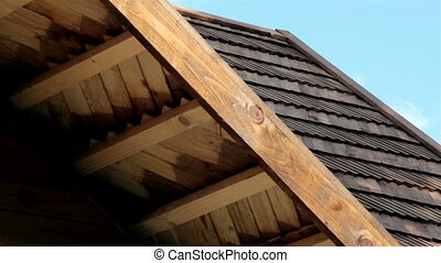 The oiled cedar wooden shingle roof of the house shake - The...