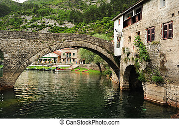 The old arched stone bridge of Rijeka Crnojevica