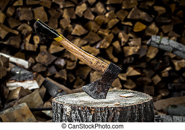 the old axe stuck in a stump