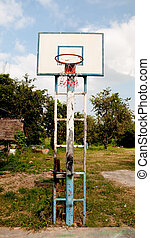 The Old basketball court on blue sky background