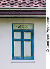 The Old blue window on wall background