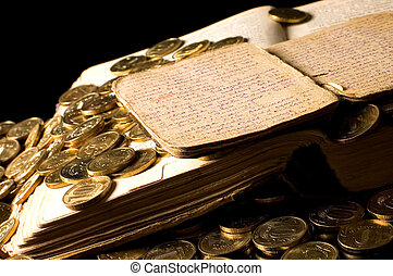 The old book with gold coins