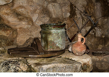 The Old bucket and the clay jug on the water well in...