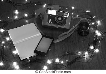 the old camera on a table with New Year fires