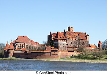 Malbork castle in Pomerania region of Poland. UNESCO World Heritage Site. Teutonic Knights' fortress also known as Marienburg. Nogat river.