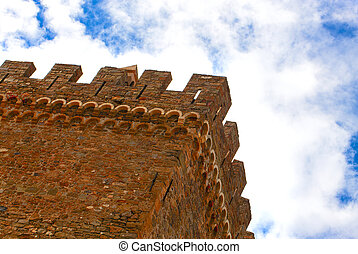 old castle on the background of blue sky with clouds