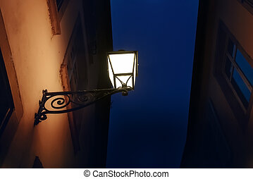 The old city lantern on the wall
