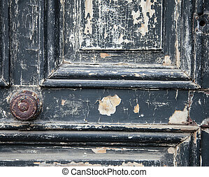 The Old Door with Cracked Paint Background closed with wood palets and vintage wall macro