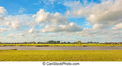 The old Dutch river IJssel near Zutphen on a sunny day
