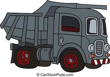 The old gray dumper truck