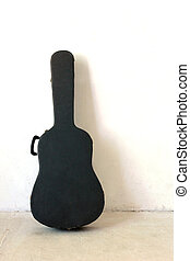 The Old Guitar case on white wall