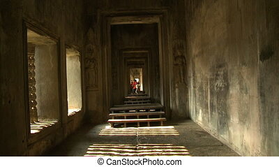 The old hallway of a temple - A hand held, long shot of the...