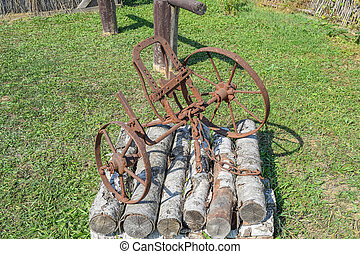 The old iron plow for digging the garden