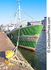 The old is not a big ship moored to the pier