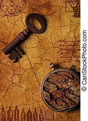 The old key with a gears on the textured paper