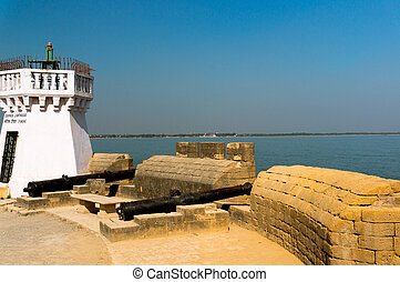 The old lighthouse on the famous tourist spot of fort diu in gujarat, overlooking the arabian sea
