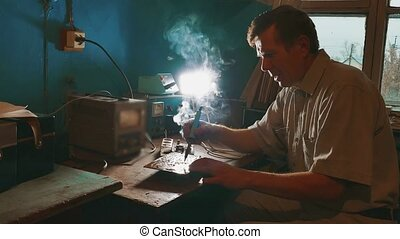 the old man repairs the chip radio technician smoke is...