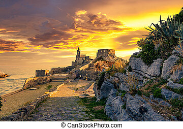 The old medieval castle in the Italian town of Porto Venere at sunset