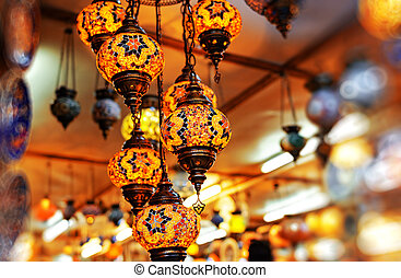 The old oriental lamp is decorated with multi-colored glass...
