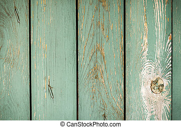 The old planks with peeling paint