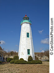 The Old Point Comfort lighthouse, a part of the new Fort Monroe National Monument, in winter against a bright blue sky