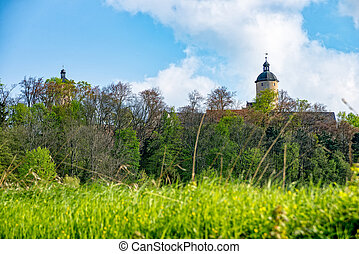 Ranis Castle behind the forest
