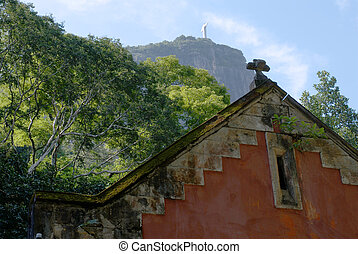 The old red house and the Corcovado Christ Statue view