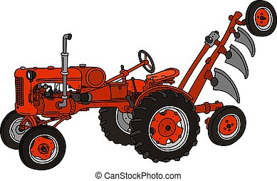 The old red tractor with a plough