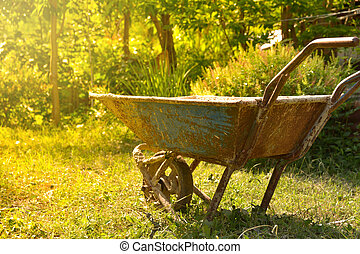 The old rusty cement cart, Cart mortar on nature background.