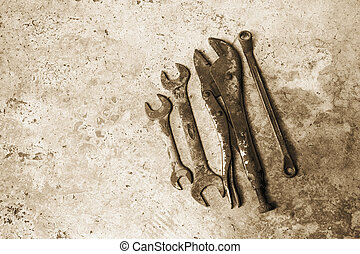 The old rusty tools supplies put on the ground sepia style