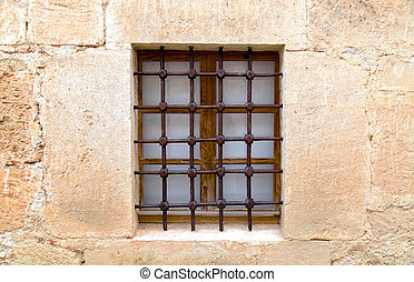 The old Sandstone walls with window and grid