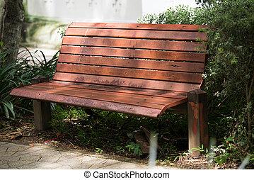 The old wooden bench in garden