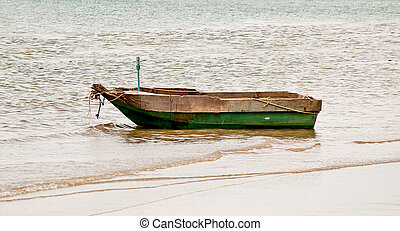 The Old wooden boat on the sea
