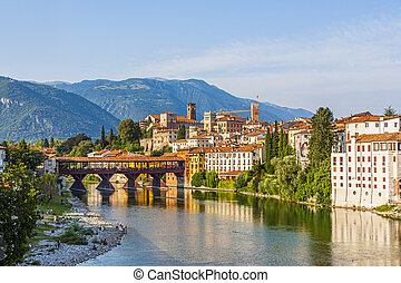 the old wooden bridge spans the river brenta at the romantic village Basano del Grappa, Italy