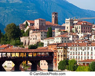 the old wooden bridge spans the river brenta at the romantic village Basano del Grappa